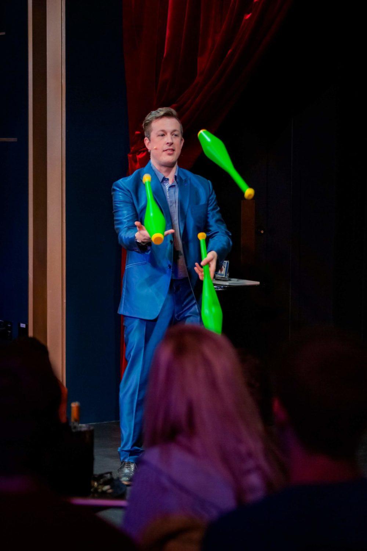 Jonathan Pritchard juggling pins at a corporate function.
